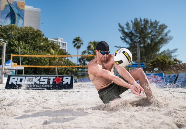 JD playing beach volleyball
