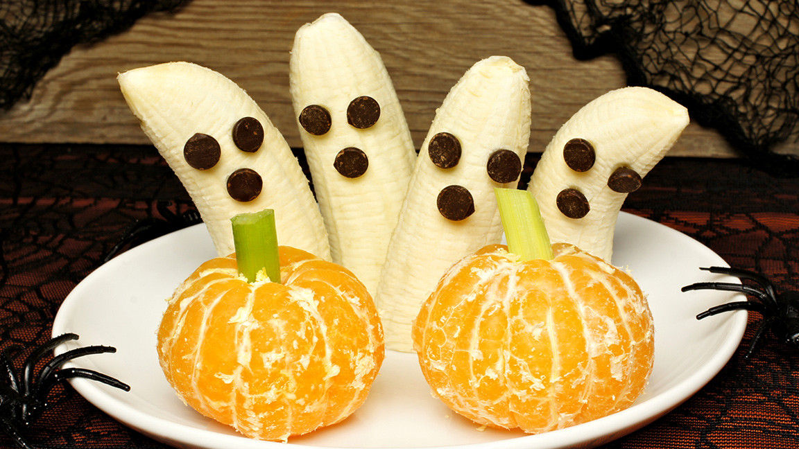 bananas made into ghosts and oranges made into pumpkins