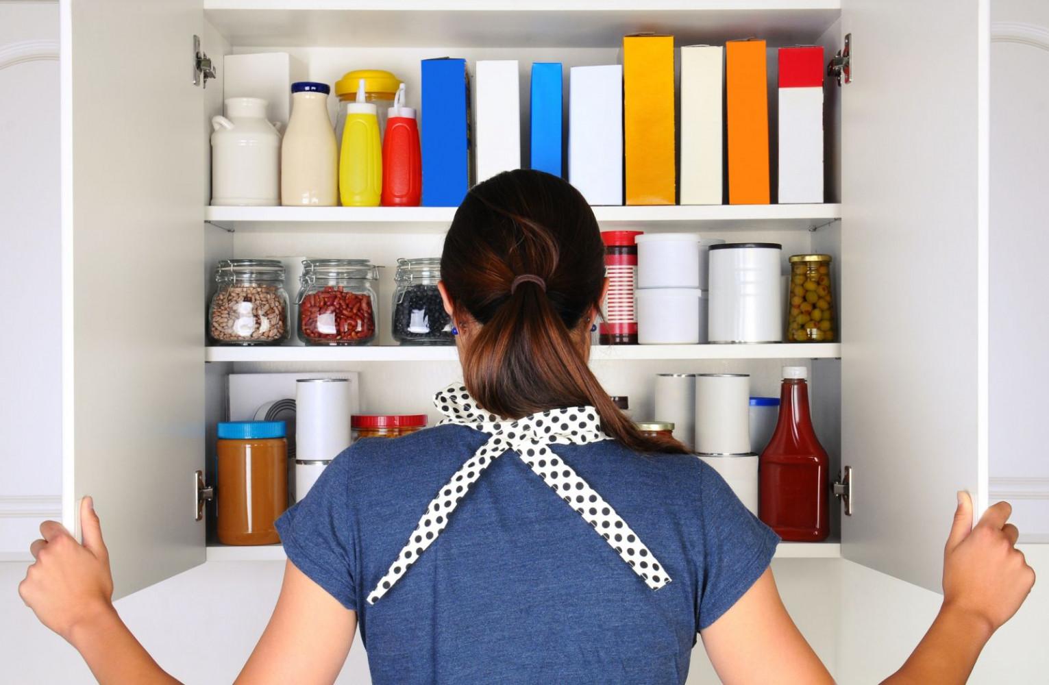woman looking in pantry