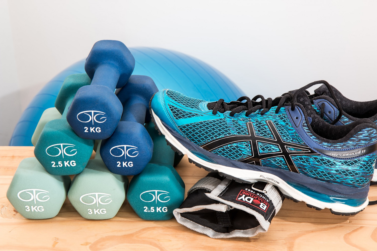 stack of hand weights and sneakers