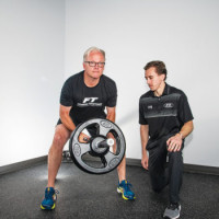 Todd P. performs a landmine row with Fitness Together's personal trainer Collin K.
