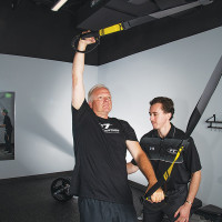 FT client Todd P. exhibits his strength on the TRX