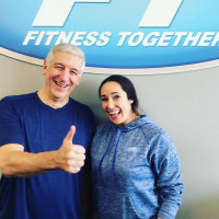 client giving thumbs up with trainer