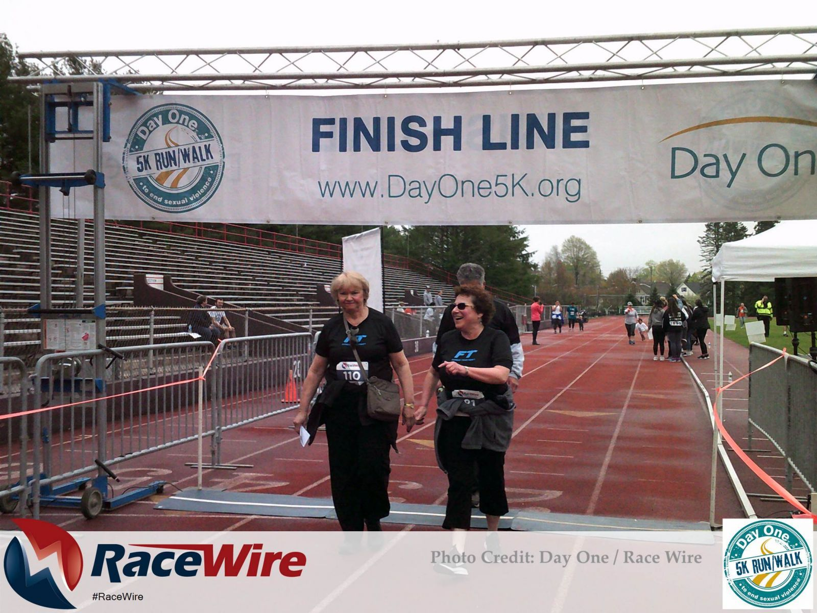 Three people crossing DayOne 5K finish line