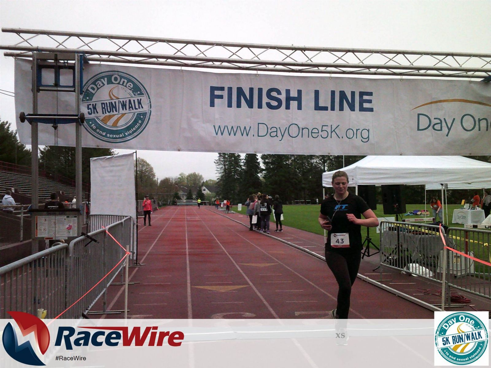 Fitness Together trainer crossing finish line