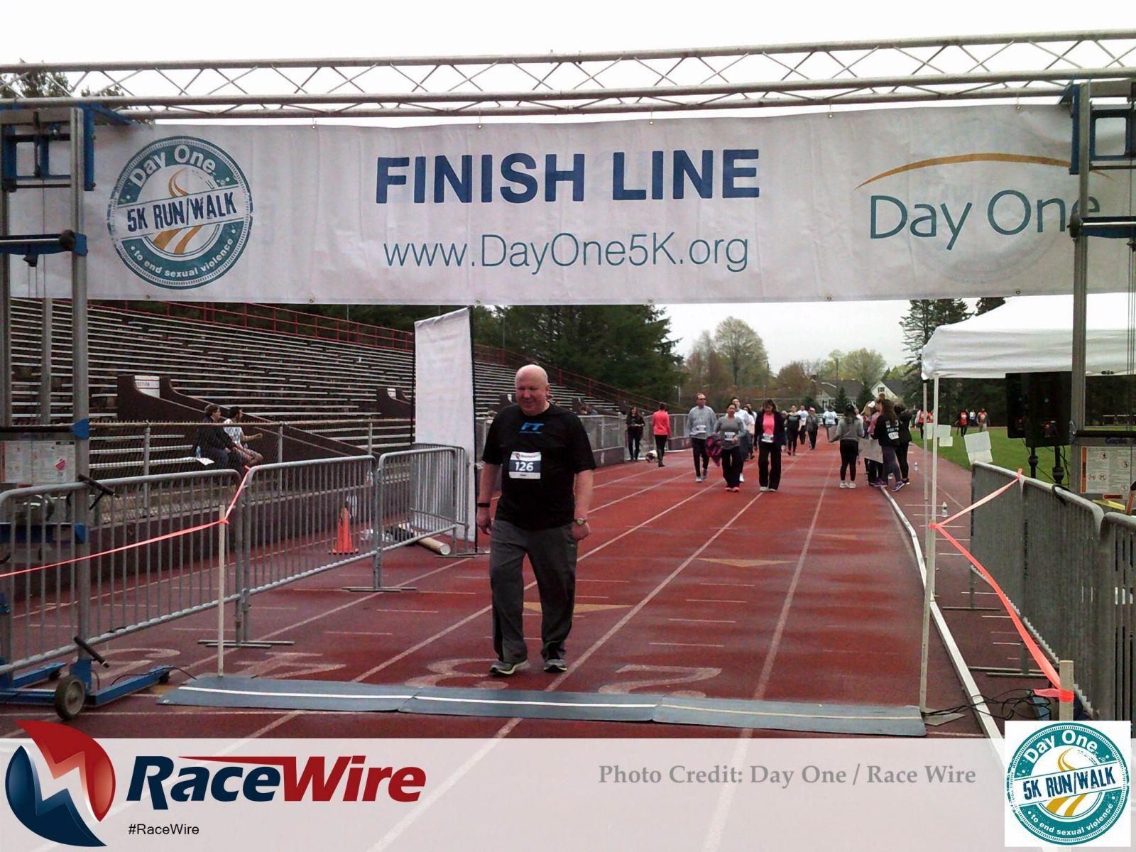 Man crossing DayOne 5K finish line