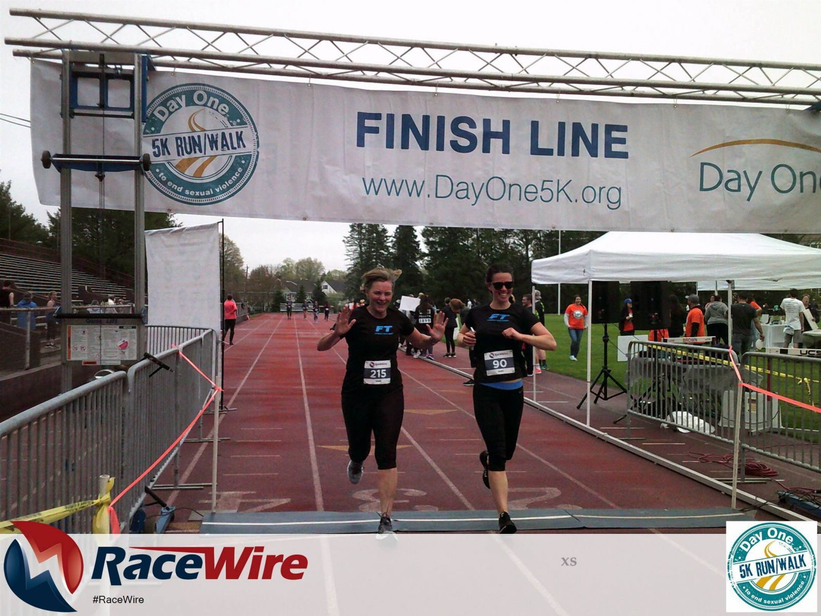 Two women excited and happy to cross 5K finish line