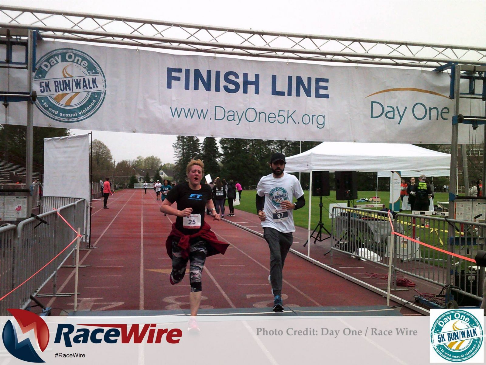 A man and a woman crossing the 5K finish line