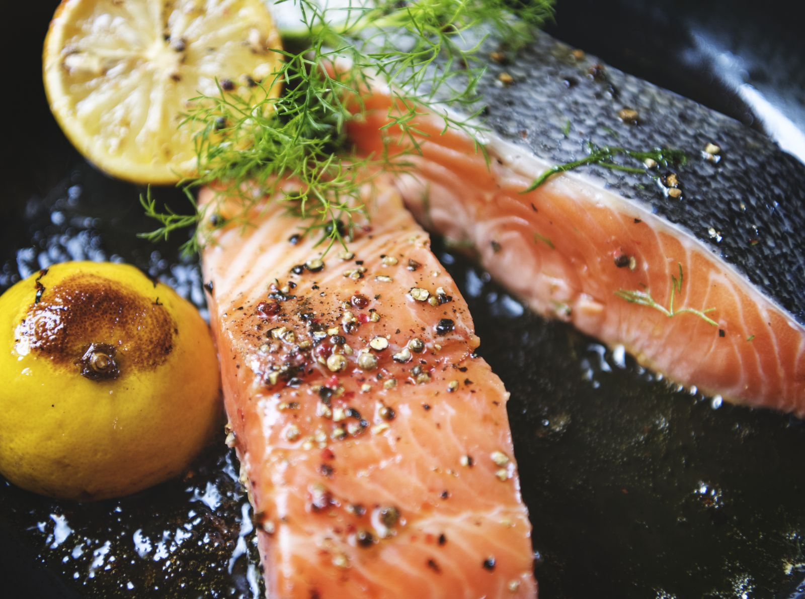Salmon being cooked with lemon