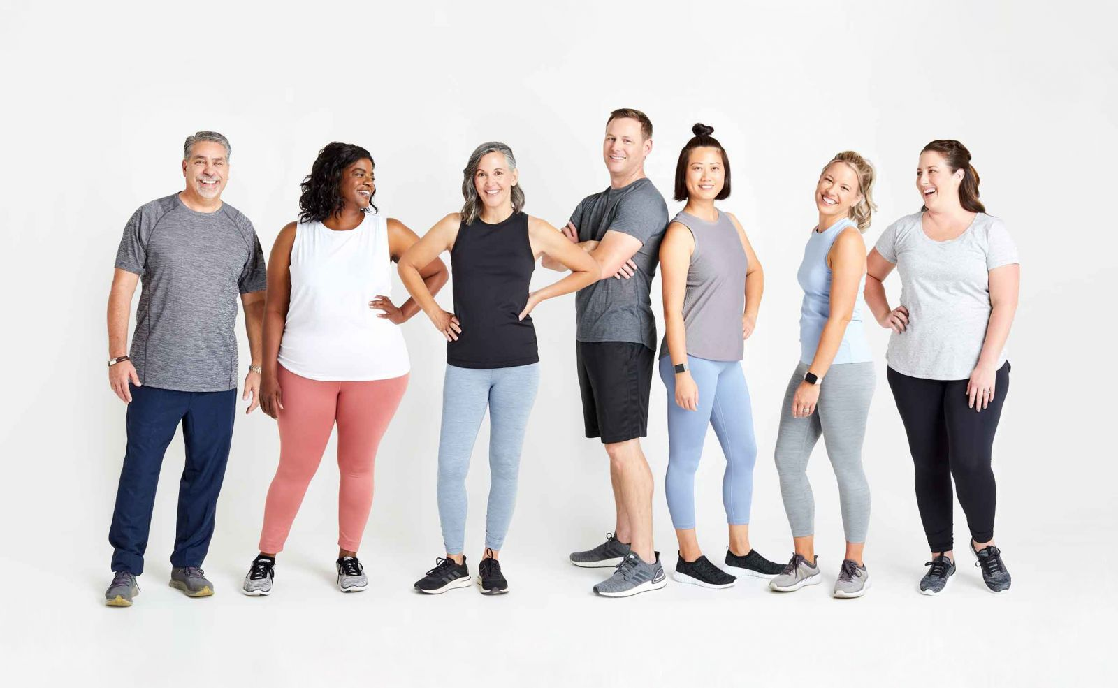 men and women in workout clothes