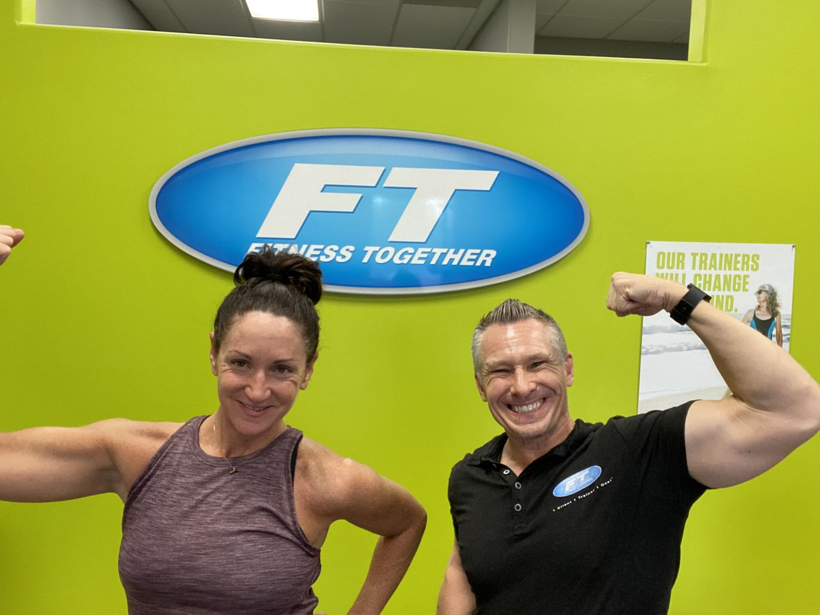 woman and man flexing biceps