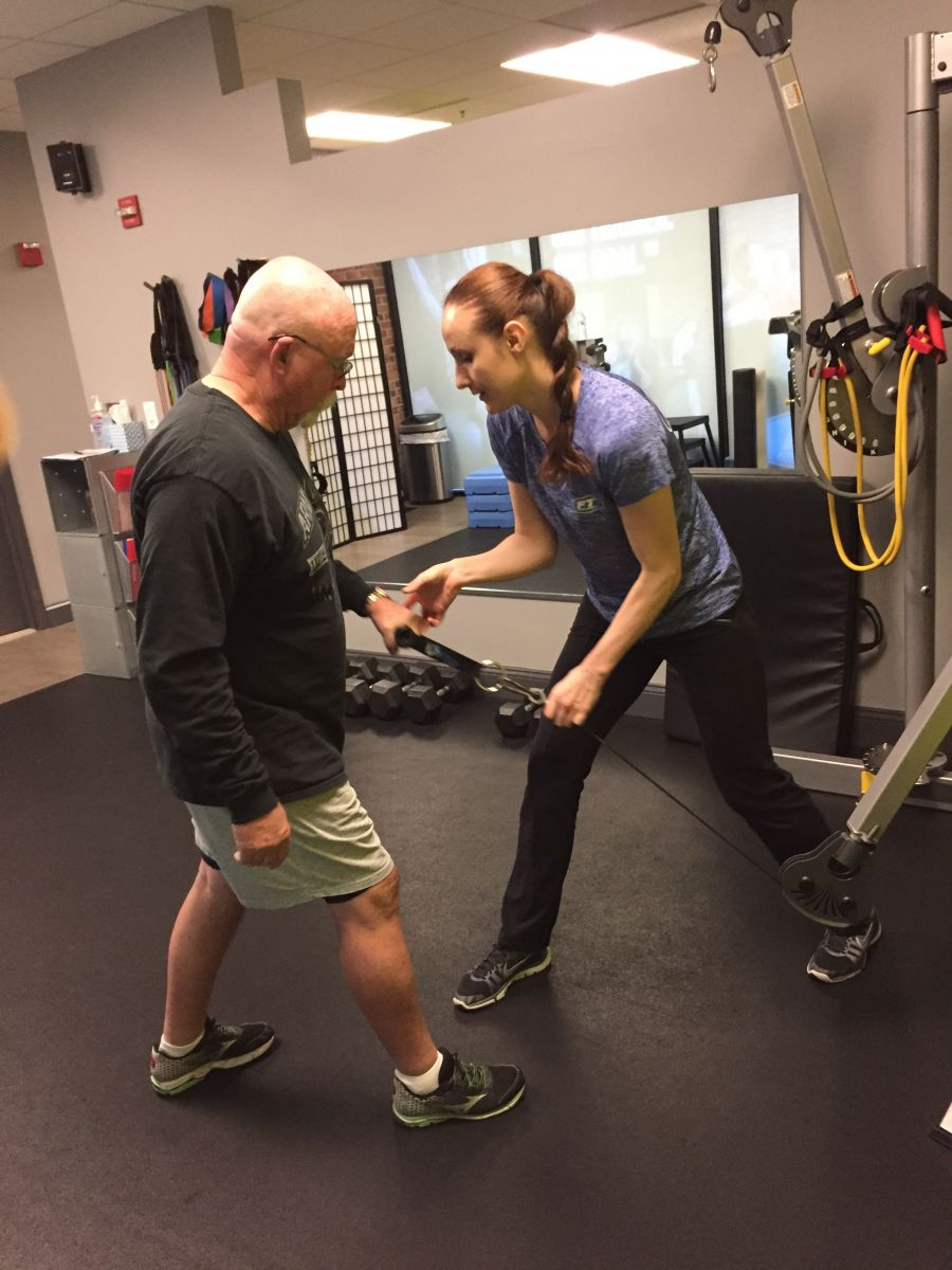 client working out with personal trainer