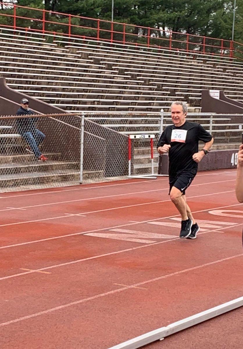 An older man running the 5K