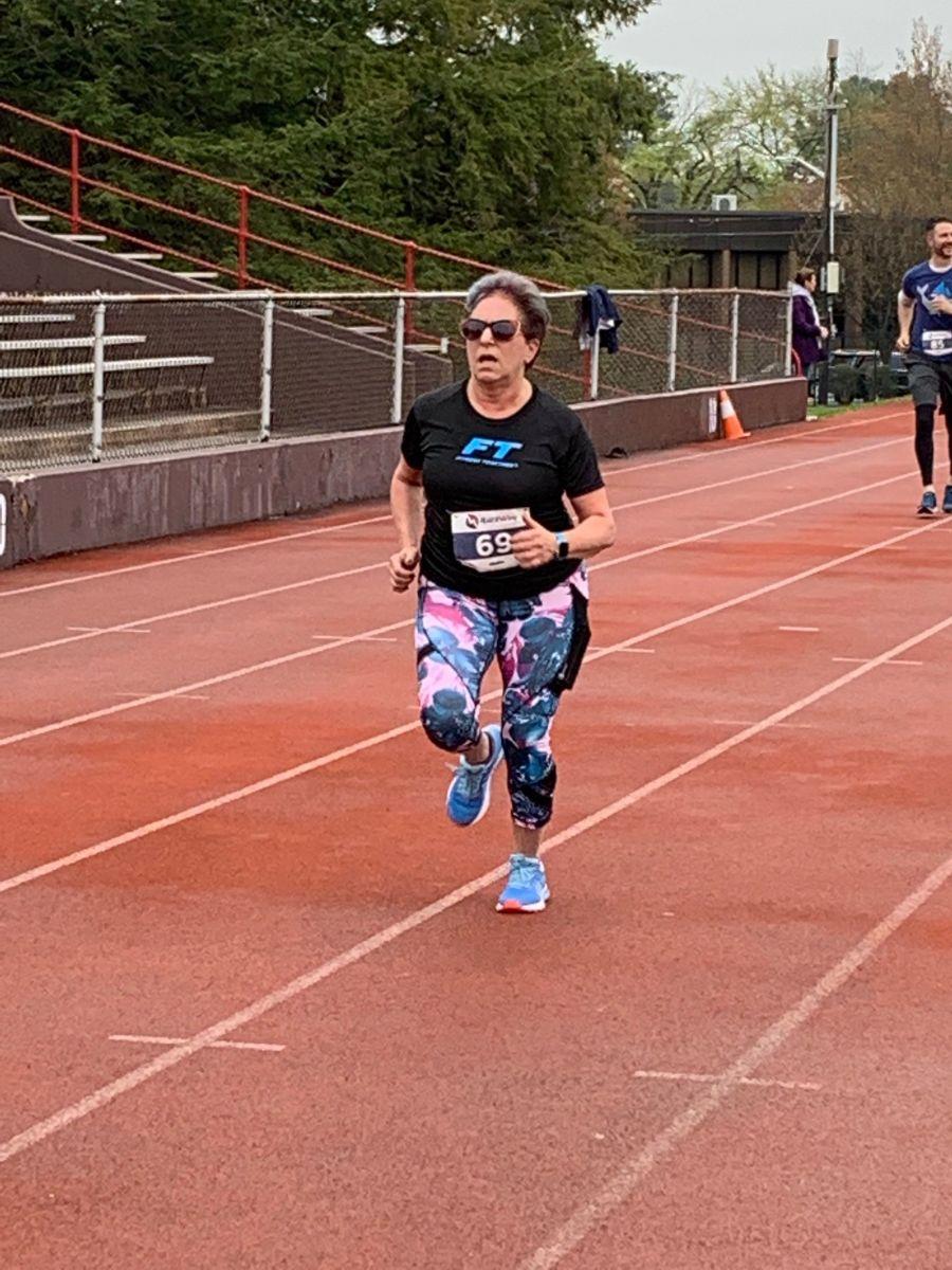 Member of Fitness Together team running 5K