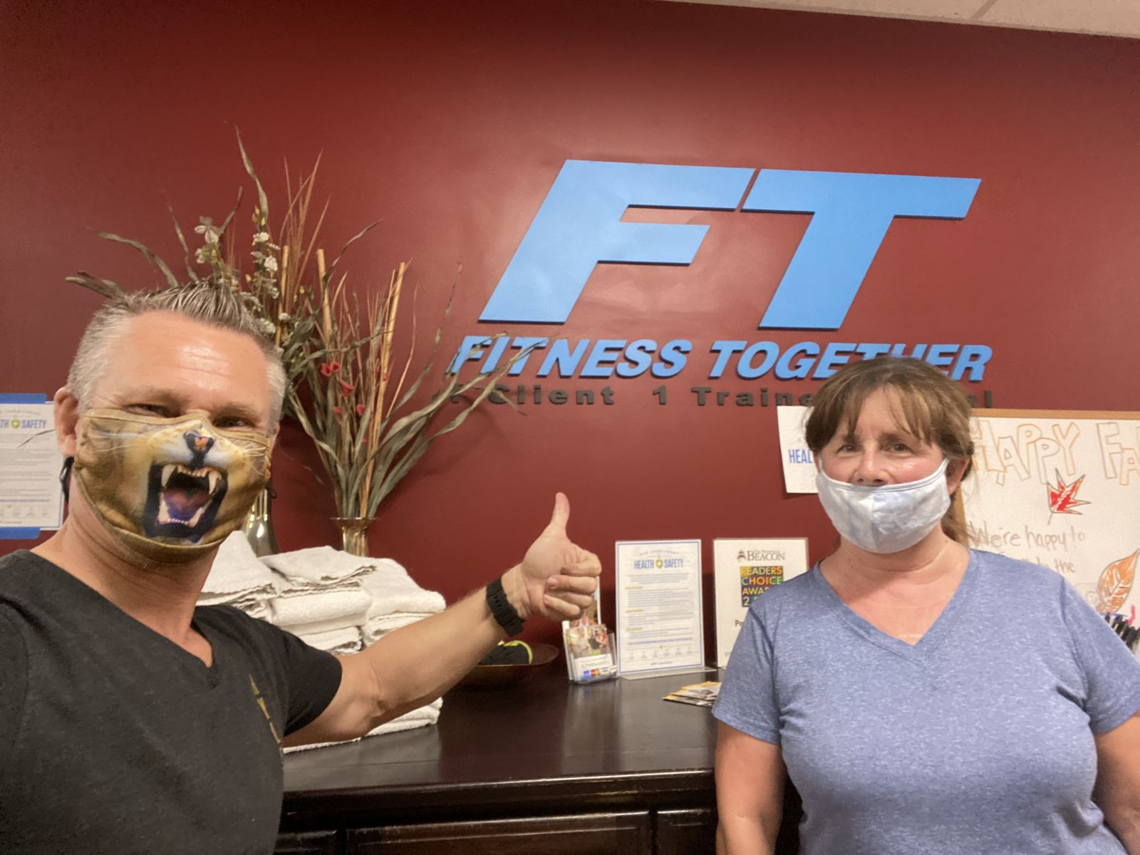 two trainers at the Fitness Together studio front desk