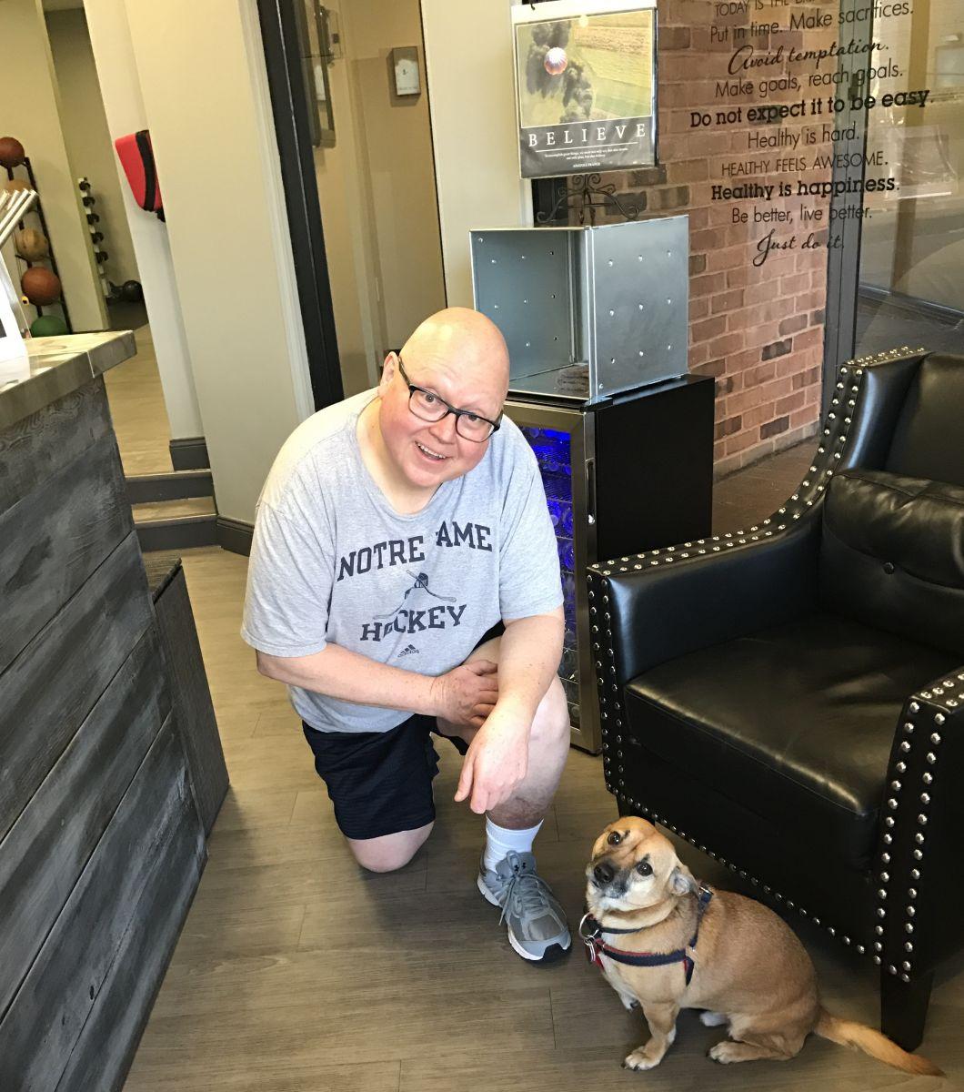 joe kneeling with dog