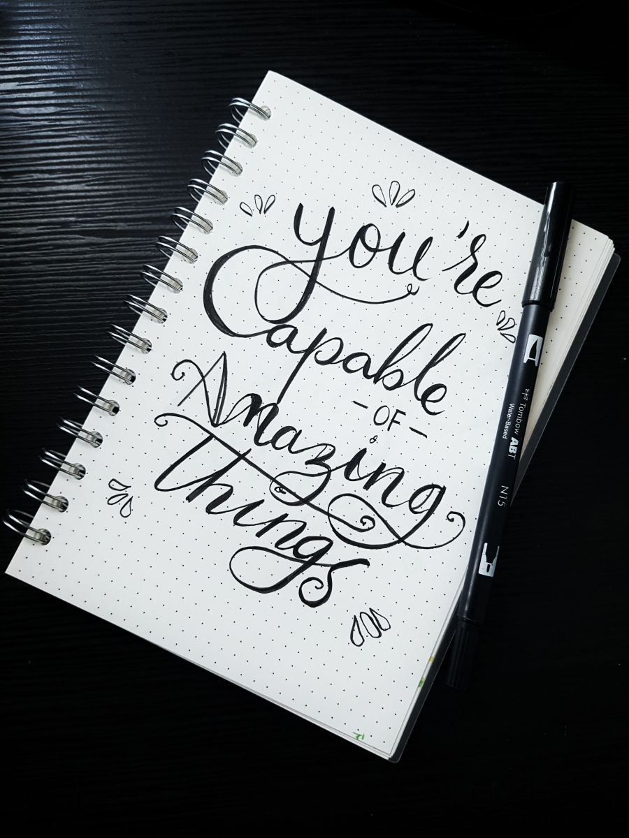 notebook cover that says you are capable of amazing things
